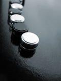 Botones blancos y negros Fotos de archivo libres de regalías