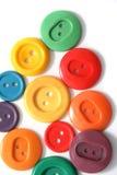 Botones coloreados en blanco Foto de archivo libre de regalías