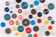 Botones coloreados en el fondo blanco Imagen de archivo libre de regalías