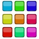 Botones coloreados en un fondo blanco Foto de archivo libre de regalías