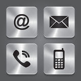 Botones de contacto del metal - iconos determinados. Fotos de archivo