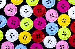 Botones de costura, botones plásticos, botones coloridos fondo, BU Fotografía de archivo