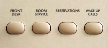 Botones de la comunicación en el teléfono del hotel Foto de archivo