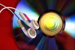 Botones de oído y CD Imagen de archivo