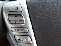 Botones del control de sistema de multimedias en el volante Fotografía de archivo libre de regalías