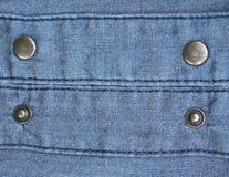 Botones del metal en fondo de los vaqueros Fotografía de archivo