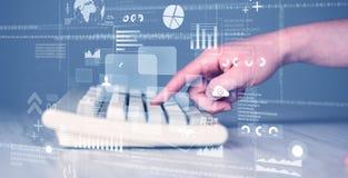 Botones del teclado presionados a mano con los iconos de alta tecnología Fotos de archivo libres de regalías