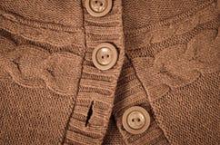 Botones en el suéter hecho punto Fotografía de archivo libre de regalías