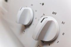 Botones en un cierre de la estufa para arriba con la profundidad del campo baja Fotografía de archivo