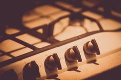 Botones en una estufa foto de archivo
