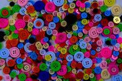 Botones multicolores brillantes Fotos de archivo libres de regalías