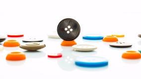 Botones multicolores de la ropa Fotografía de archivo