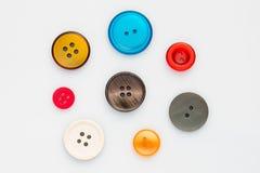 Botones multicolores de la ropa Fotos de archivo