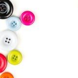 Botones multicolores en el fondo blanco Fotografía de archivo