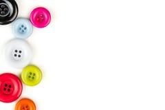 Botones multicolores en el fondo blanco Fotografía de archivo libre de regalías