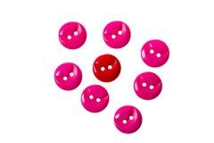 Botones rojos y rosados en blanco foto de archivo libre de regalías
