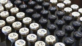 Botones viejos de la máquina sumadora Fotos de archivo libres de regalías