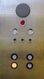 Botones viejos del panel de control de elevador en estilo retro análogo Foto de archivo libre de regalías