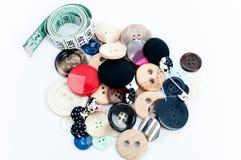 Botones y cinta métrica Imagen de archivo libre de regalías