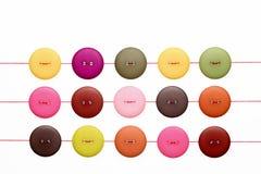 Botones y cuerdas de rosca Foto de archivo