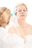 Botox - Age and beauty. A doctor is doing the injection Royalty Free Stock Images