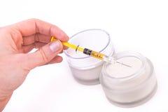 Botox cream with syringe Royalty Free Stock Image