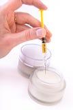 Botox cream with syringe Stock Photos