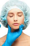 Botox injection. Cosmetic injection of botox to the pretty female face, under eye. Isolated on white background royalty free stock images