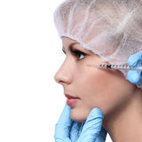 Botox injection in beautiful female face isolated on white. Cheek zone. Royalty Free Stock Photo