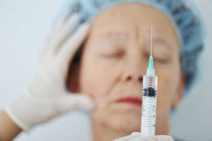 Botox injection ready. Senior woman Royalty Free Stock Photo