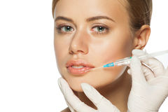 Botox injection to the lips Royalty Free Stock Photos