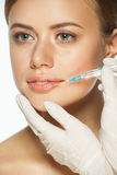 Botox injection to the lips Royalty Free Stock Image