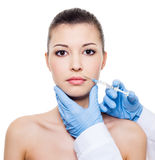 Botox  injection in woman lips Royalty Free Stock Photo