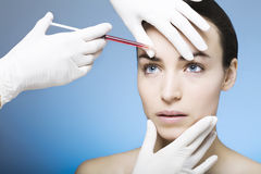 Botox injection for a young woman Stock Photography