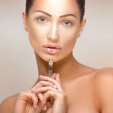 Botox injections. Beauty portrait of attractive woman giving botox injections Stock Image