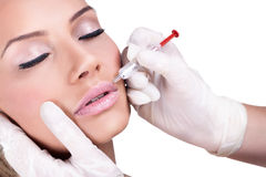 Botox injektionbehandling. Arkivfoto