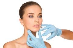 BOTOX® injecties op jonge vrouw stock afbeeldingen
