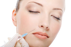 Botox shot in the female cheek. Female  face close-up Royalty Free Stock Photos