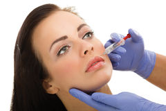 Botox shot in the female cheek Stock Photos