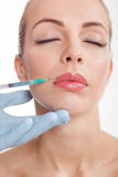 Botox shot in the female lips Royalty Free Stock Photo