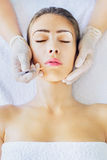 Botox treatment. Botox lips injection, caucasian woman and cosmetologist Stock Photos
