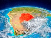 Botswana on Earth. Orbit view of Botswana highlighted in red on planet Earth with highly detailed surface textures. 3D illustration. Elements of this image Royalty Free Stock Photo