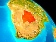 Botswana on Earth. Space orbit view of Botswana highlighted in red on planet Earth with visible borders. 3D illustration. Elements of this image furnished by Stock Photography