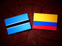 Botswana flag with Colombian flag on a tree stump isolated royalty free illustration