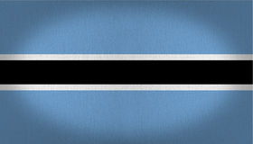 Botswana flag. Composed by a black line in the center with two thin lines in white at the sides of it, all over a light blue back, fabric texture background Stock Image