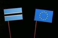 Botswana flag with European Union EU flag isolated on black. Background Stock Photos