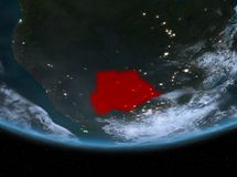 Botswana at night. Highlighted in red on planet Earth with clouds. 3D illustration Stock Photo