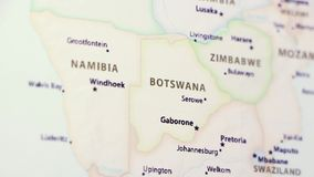 Botswana on a Map. Botswana on a political map of the world. Video defocuses showing and hiding the map stock footage