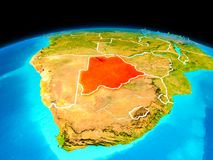Botswana in red. Satellite view of Botswana highlighted in red on planet Earth with borderlines. 3D illustration Stock Photos