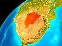 Botswana from space. Orbit view of Botswana highlighted in red with visible borderlines on planet Earth. 3D illustration. Elements of this image furnished by Stock Photos